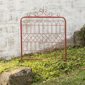 vintage distressed red garden gate with scrollwork