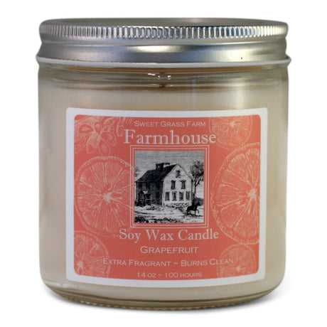 grapefruit scented soy candle in glass jar