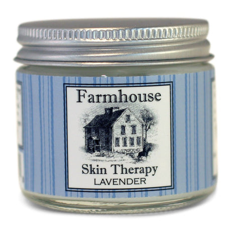 small jar with blue label and illustration of farmhouse containing hand cream