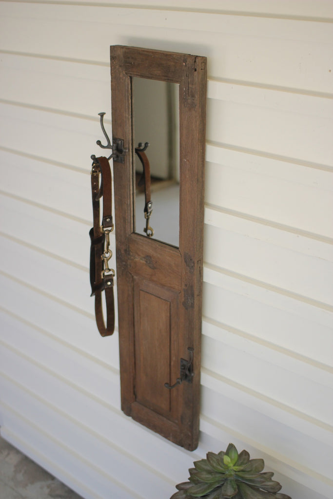 antique wood door panel with hook and mirror