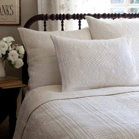creamy white cotton percale embroidered quilt
