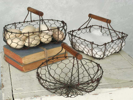 set of three chicken wire baskets--round, oval, and square--with wooden handles