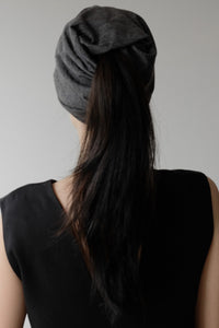 - open back versa toque for pony tail