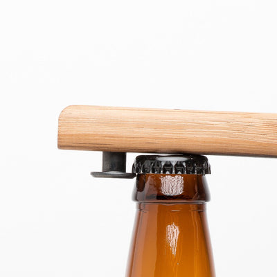 Quercus Alba Reclaimed Wood Bottle Opener on bottle cap ready to open