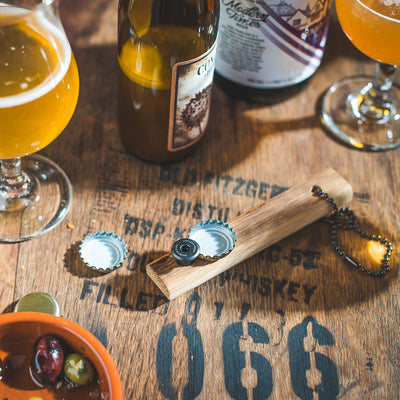 Quercus Alba Reclaimed Wood Bottle Opener in use bottle share