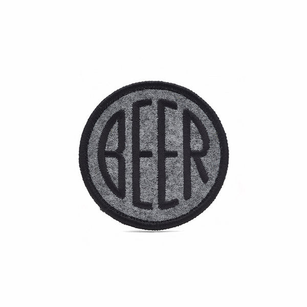 Embroidered BEER patch with black embroidery thread on heather grey felt