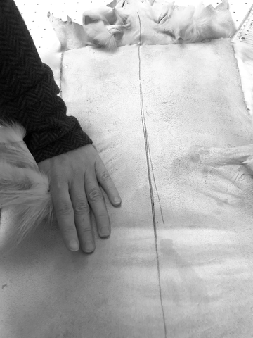 Stretching the individual skins by hand