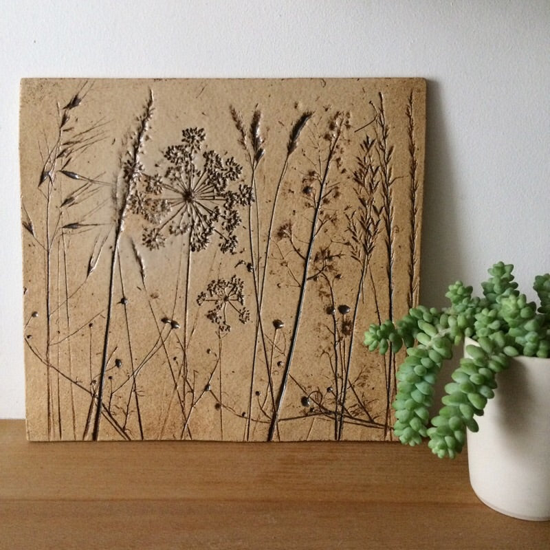 Small botanical decorative tile