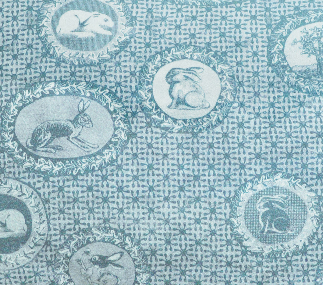Toile de Jouy style fabric,with rabbits and bunnies printed faded turquoise blue colour,classic style independent designer,textiles,patterns by the metre.