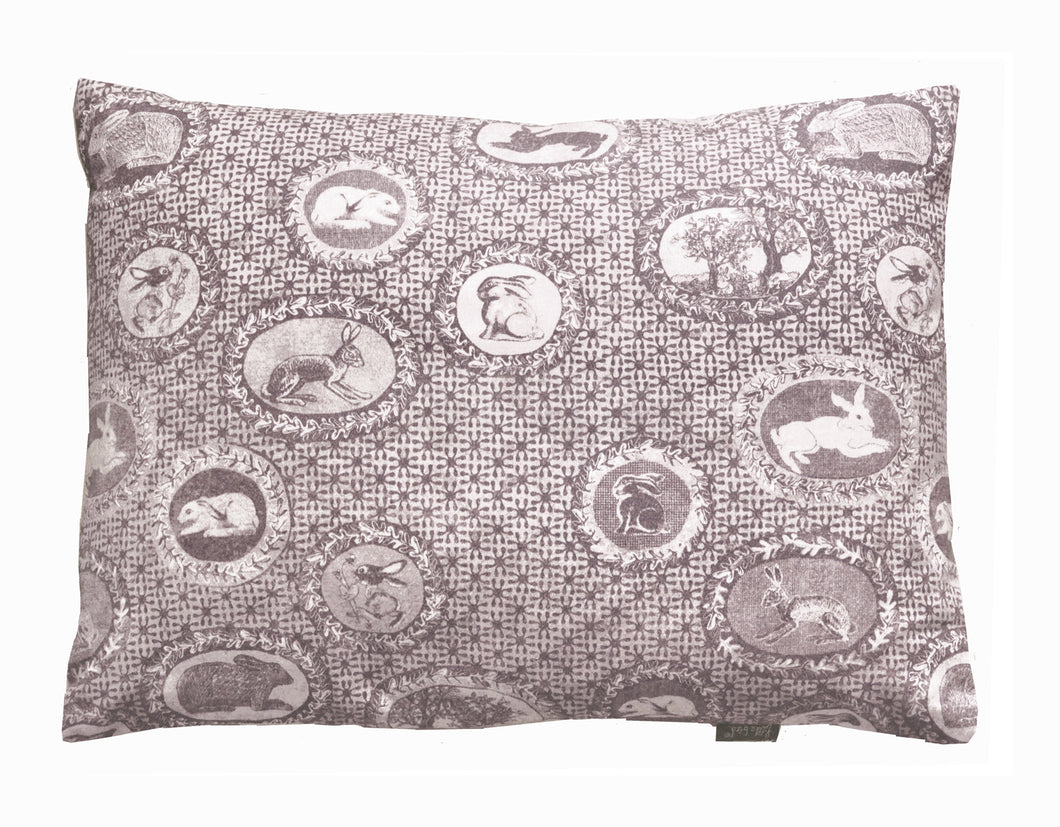 patterned cotton cushion,bunnies and rabbits printed in chocolate brown,a twist on Toile de jouy,English designer based in Norfolk.Pattern lovers choice.