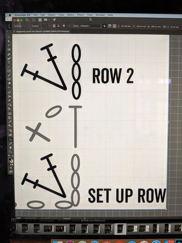 a computer screen shows a crochet chart being drawn using illustrator