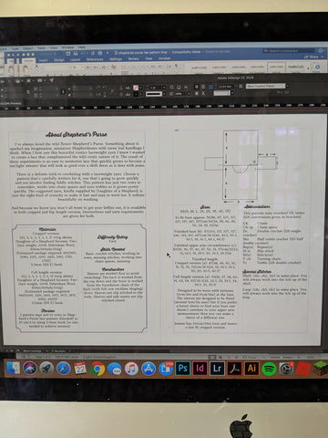a computer screen shows a page view of a new crochet pattern in Indesign