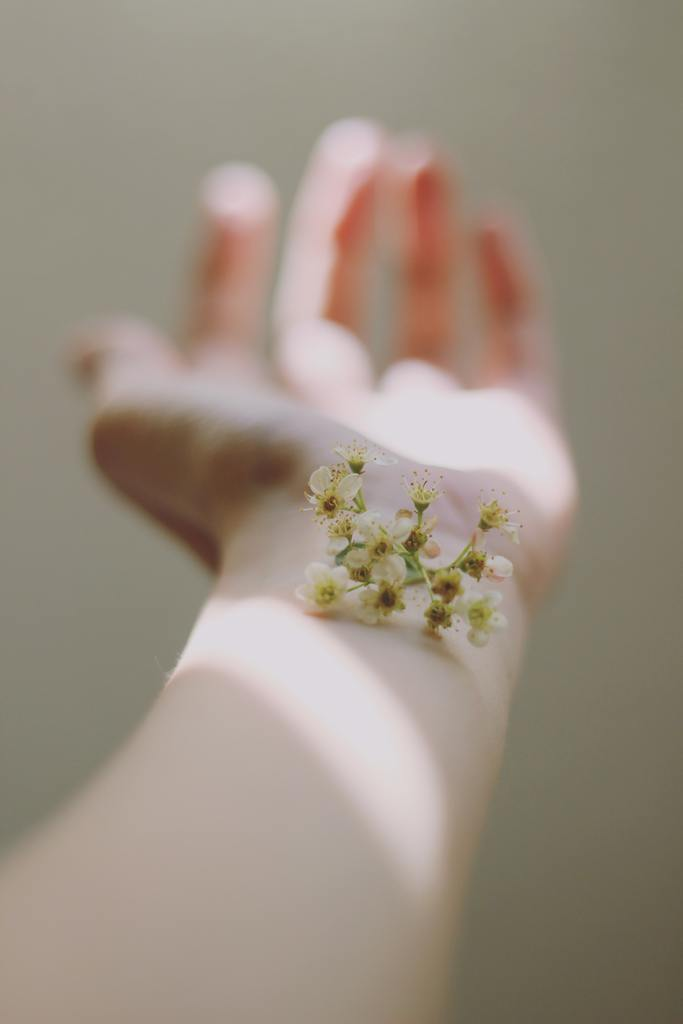 Tips for eczema and rosacea skin care - flower on wrist