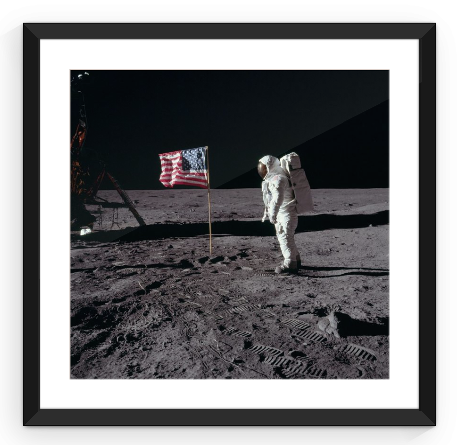 Apollo Astronaut with American Flag - Framed Print