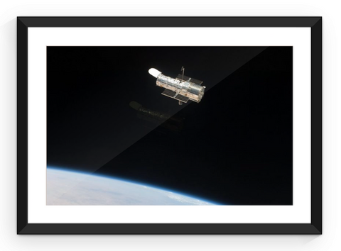 Hubble Returns to Orbit - Framed Print