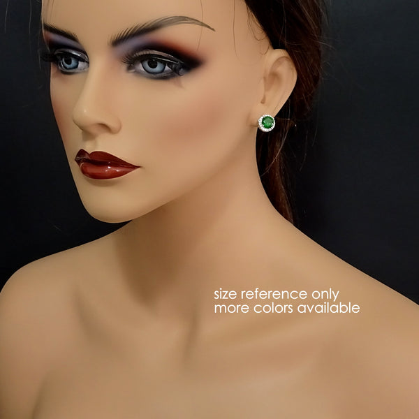 round dark green cubic zirconia crystal stud earrings on a model mannequin