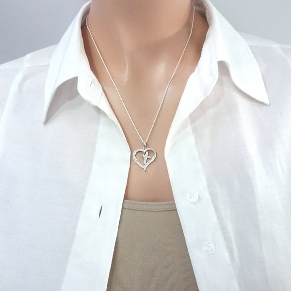 heart and cross necklace on a model mannequin