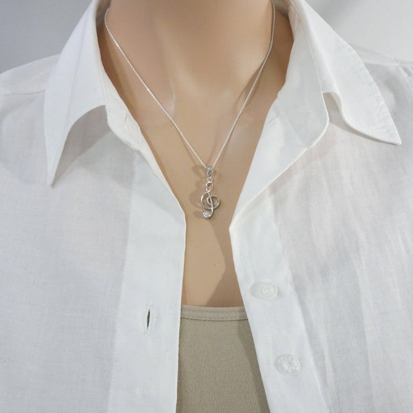 treble clef necklace on a model mannequin