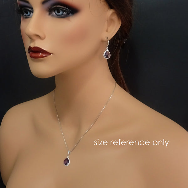 dark purple framed glass necklace and earrings on a model mannequin