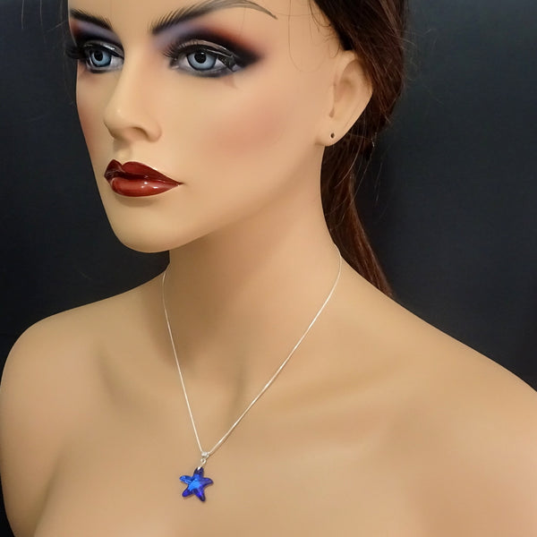 bermuda blue crystal starfish necklace on a model mannequin