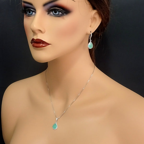 mint green framed glass necklace and earrings on a model mannequin