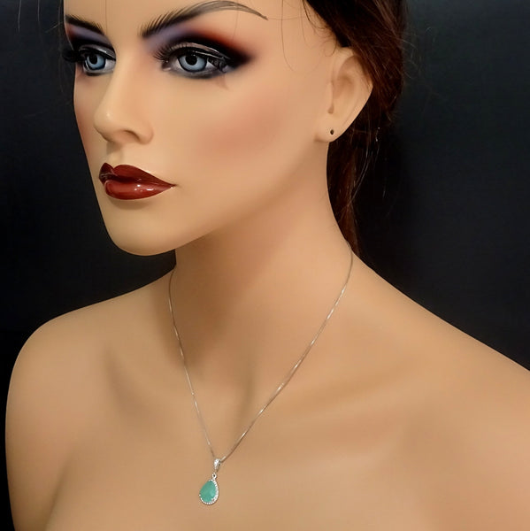 mint green framed glass necklace on a model mannequin
