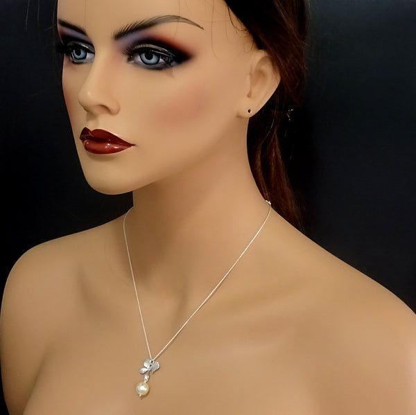 orchid and pearl necklace and earrings set on a model mannequin