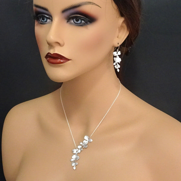 cascade orchid necklace and earrings on a model mannequin