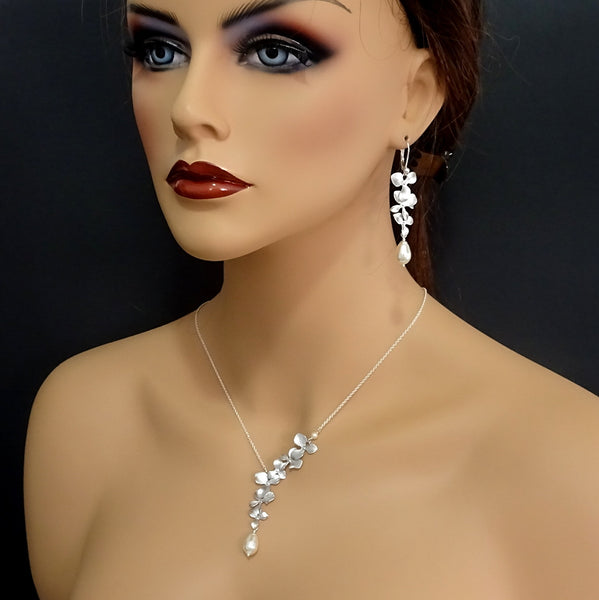 orchid and ivory pearl necklace and earrings set on a model mannequin