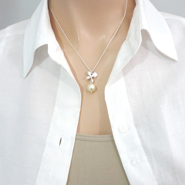 ivory pearl and orchid necklace on a model mannequin