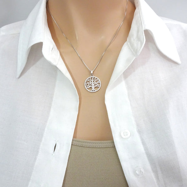tree of life cubic zirconia necklace on a model mannequin