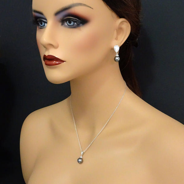dark grey pearl cubic zirconia necklace and earrings set on a model mannequin