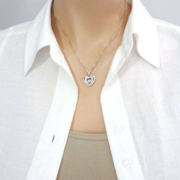 heart with cz stone necklace on a model mannequin