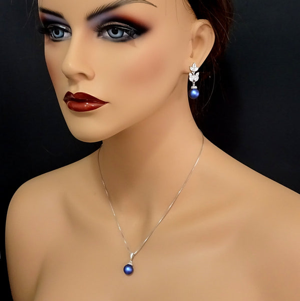 cubic zirconia iridescent blue pearl necklace and earrings set on a model