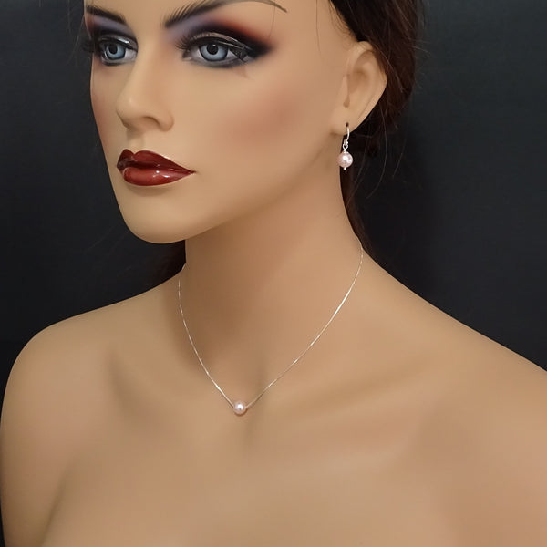 floating pearl necklace and earrings on a model mannequin