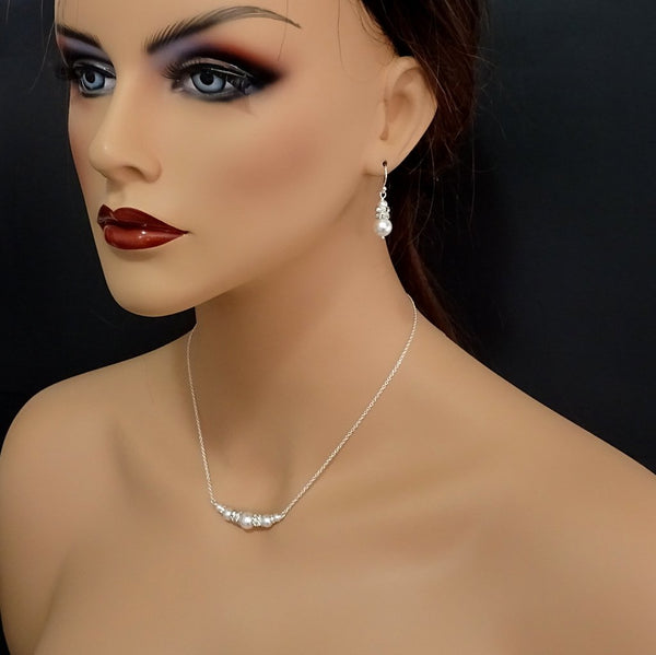 pearl and crystal necklace and earrings set on a model mannequin