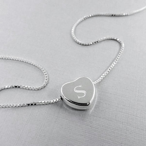 heart necklace engraved with letter S
