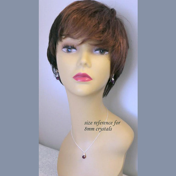 crystal and pearl necklace and earrings on a model mannequin