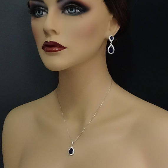 dark blue cubic zirconia drop crystal necklace and earrings set on a model mannequin