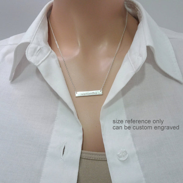 customizable engraved bar necklace on a model mannequin