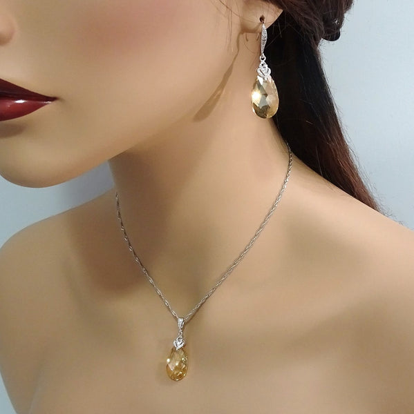 golden shadow crystal necklace and earrings set on a model mannequin