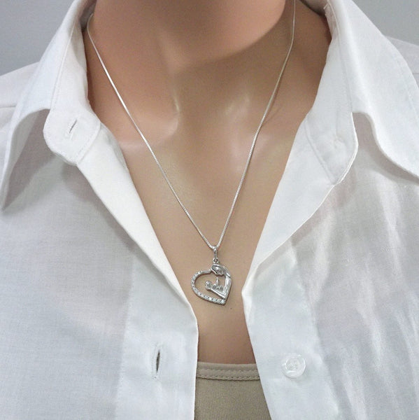 mother and child heart necklace on a model mannequin