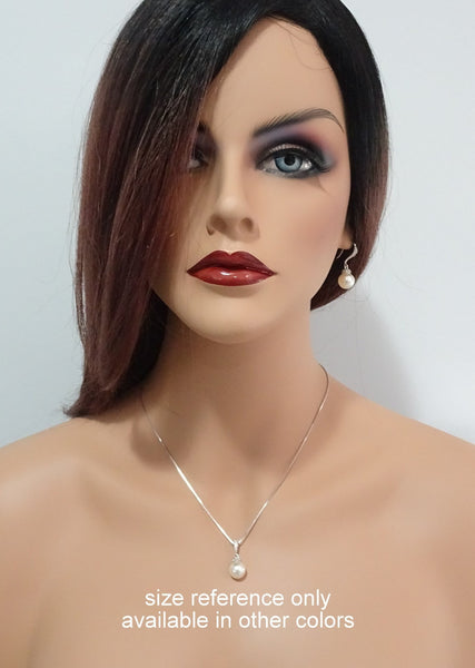 necklace and earrings on a model mannequin