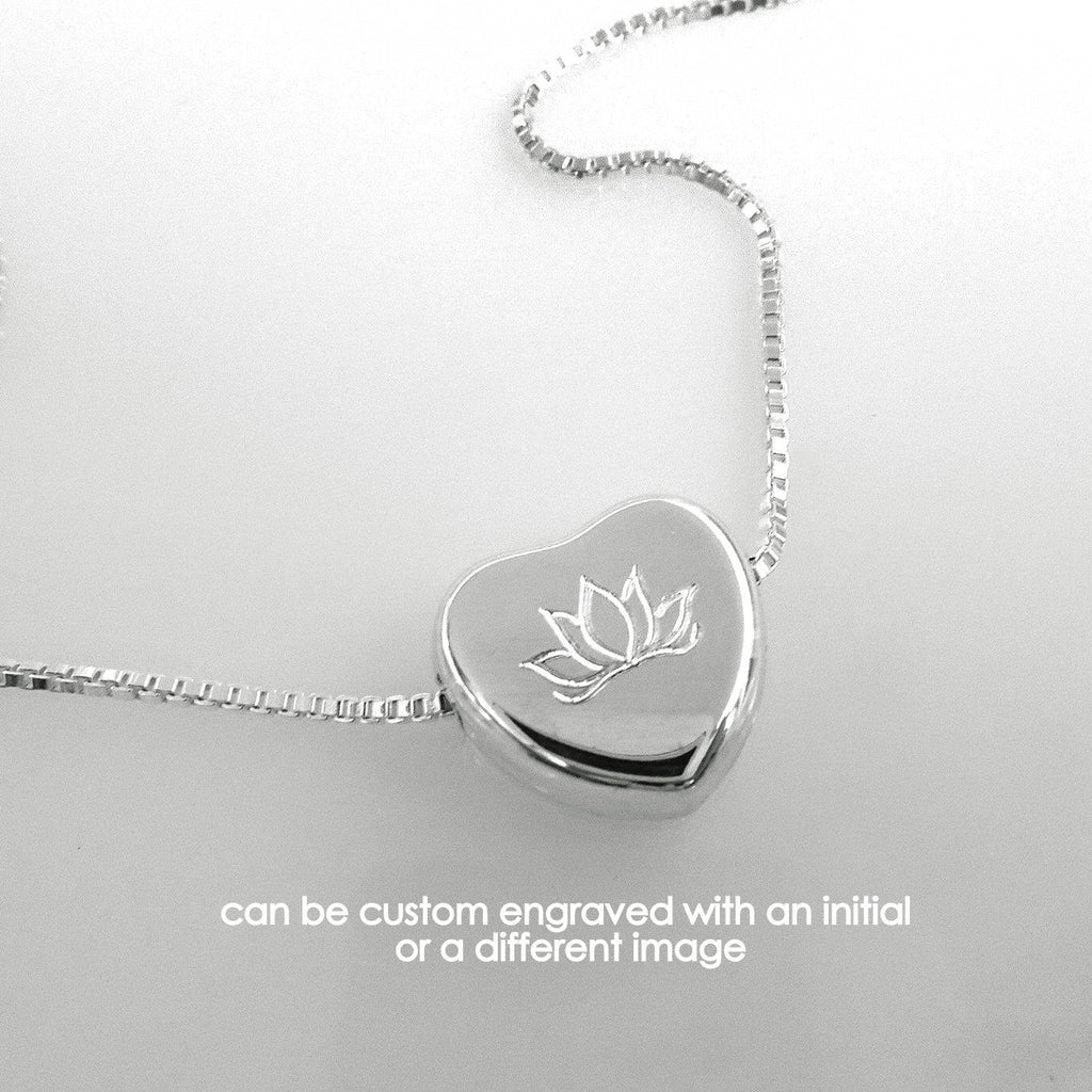 heart necklace engraved with lotus flower