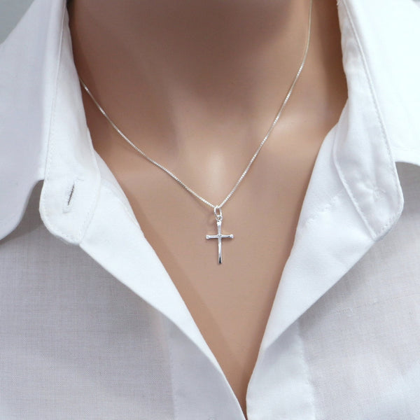 cross necklace on a model mannequin