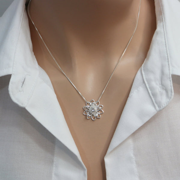 crystal flower necklace on a model mannequin