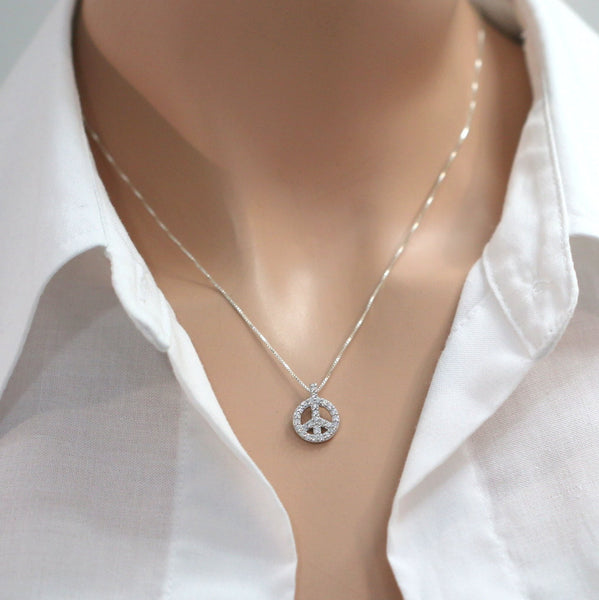 cubic zirconia peace sign necklace on a model mannequin