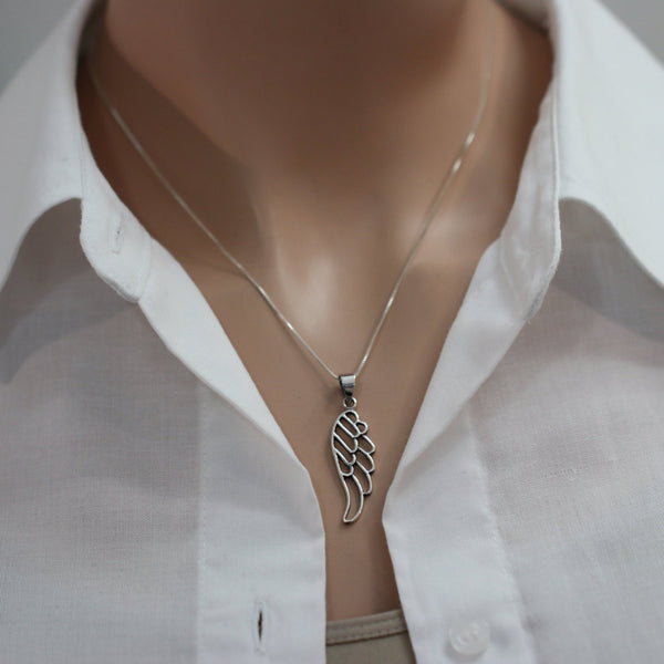 angel wing necklace on a model mannequin