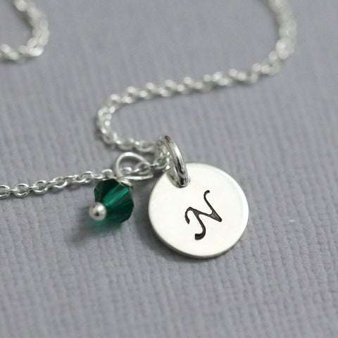stamped disc with emerald green crystal necklace