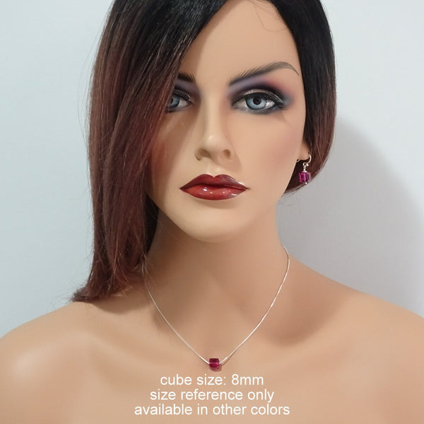 fuschia cube necklace and earrings on a model mannequin